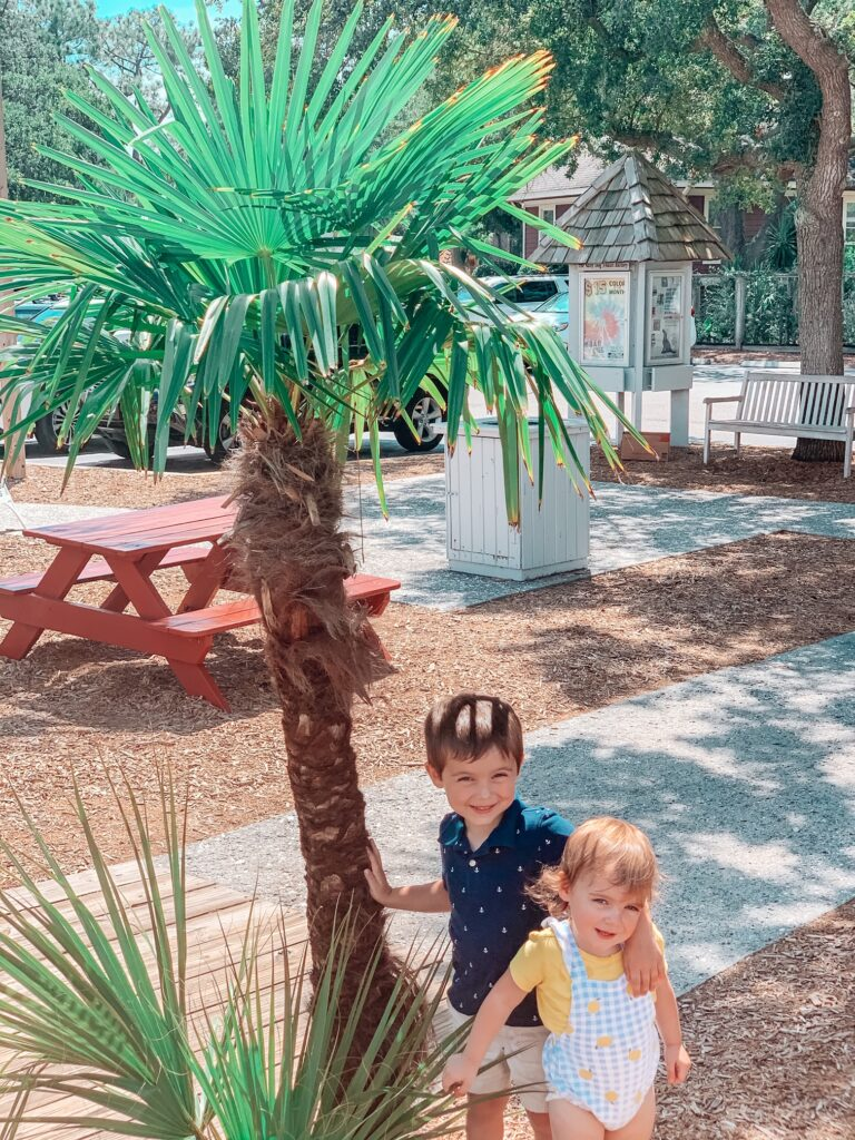 kids in front of palm tree
