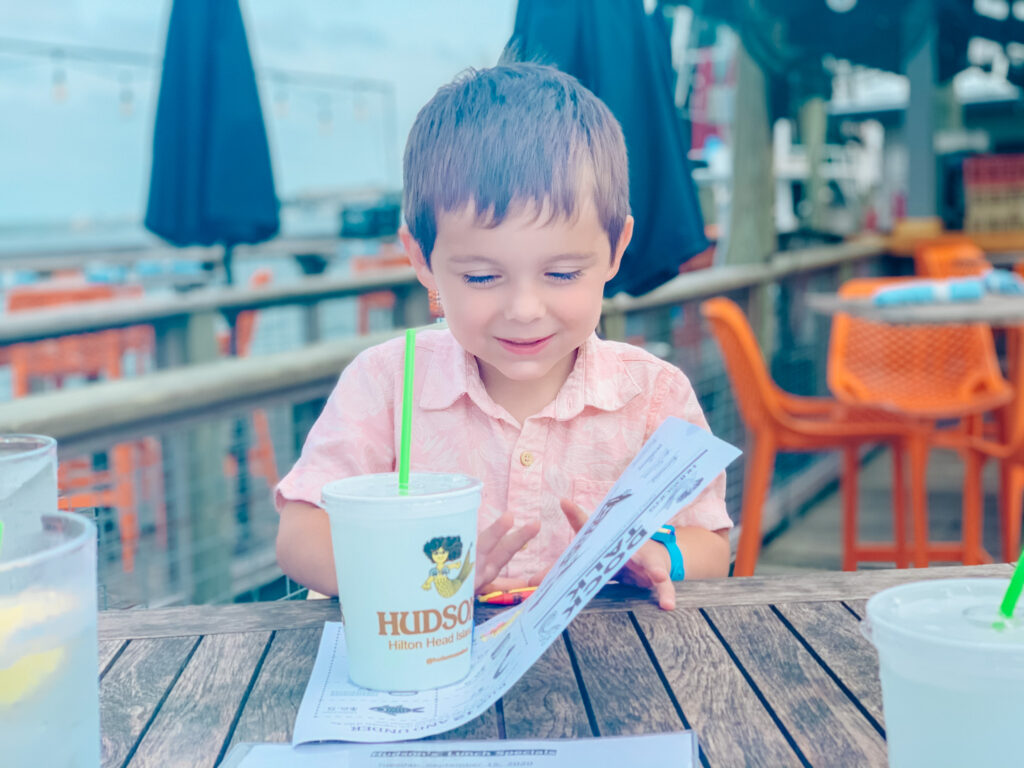 boy eating at hudson's hilton head